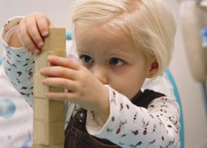 girl building with blocks